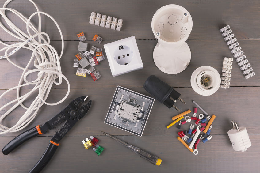 electrical tools and accessories on wooden table
